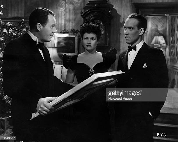 A dramatic moment for British actors Margaret Lockwood Ian Hunter and Barry K Barnes in the John Corfield production of 'Bedelia' when Ben gives...