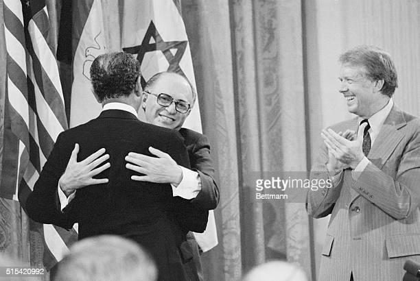 Dramatic Moment. Washington: U.S. President Jimmy Carter applauds as Israeli Prime Minister Menachem Begin and Egypt's President Anwar Sadat embrace...