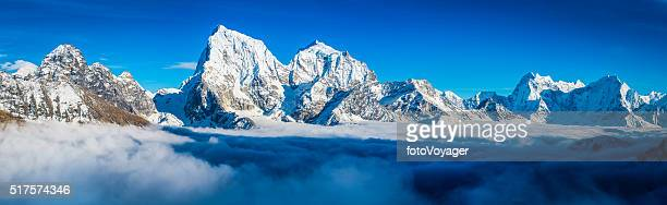 Dramatic mountain peaks panorama snowy summits above clouds Himalayas Nepal