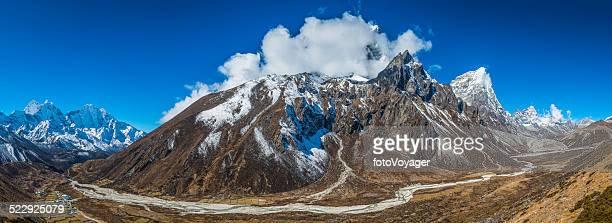 Dramatic mountain peaks pinnacles panorama overlooking Sherpa villages Himalayas Nepal