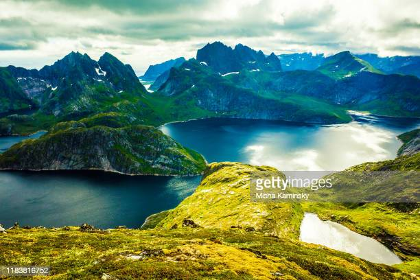 dramatic mountain scenery of the cloudy lofoten islands, norway - atlantic ocean stock pictures, royalty-free photos & images