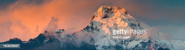 Dramatic mountain summit sunset panorama Annapurna Himalayas Nepal