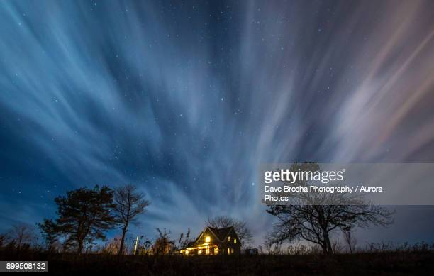 dramatic night exposure over country farmhouse - farmhouse stock pictures, royalty-free photos & images