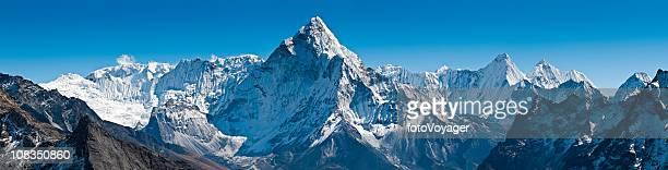 Dramatic peaks pinnacles snowy summits high altitude mountain panorama Himalayas