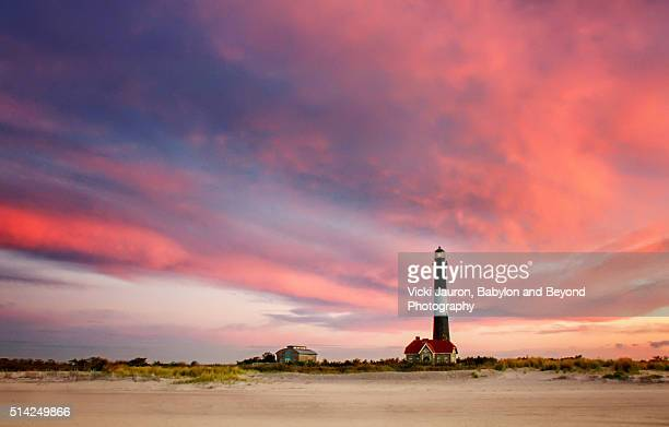 dramatic pink sunrise at fire island lighthouse - long island stock pictures, royalty-free photos & images