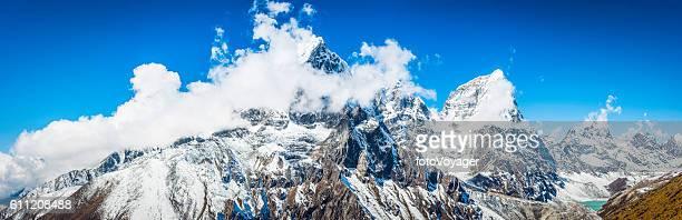 Dramatic pinnacles Taboche 6501m Cholatse 6440m Himalaya mountains panorama Nepal