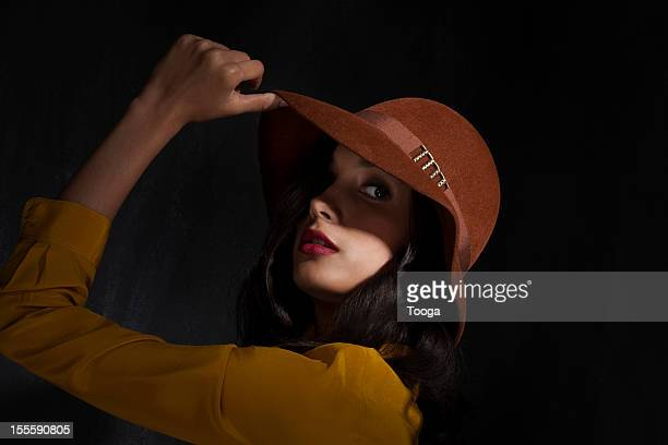 Dramatic portrait of woman wearing felt hat