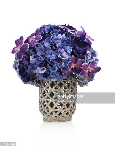 Dramatic purple hydrangea and orchid bouquet on white background