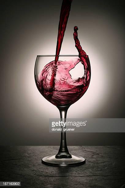 Dramatic Red Wine Splash into Wine Glass