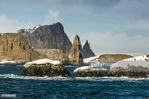 dramatic reefs and islets in english strait, south shetland island group, drake passage, antarctica, polar regions - drake passage stock photos and pictures