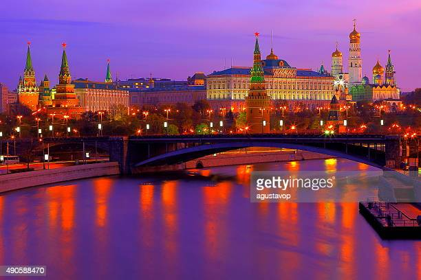Dramatic Russian Kremlin, Red Square, colorful sunrise bright reflection, Moscow