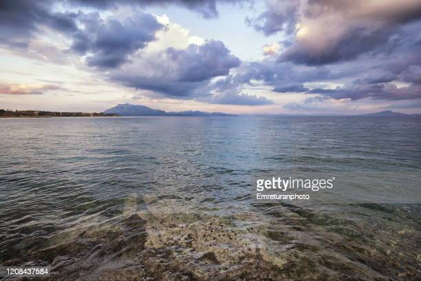 dramatic sea view from datca on a cloudy day in winter. - emreturanphoto stock pictures, royalty-free photos & images