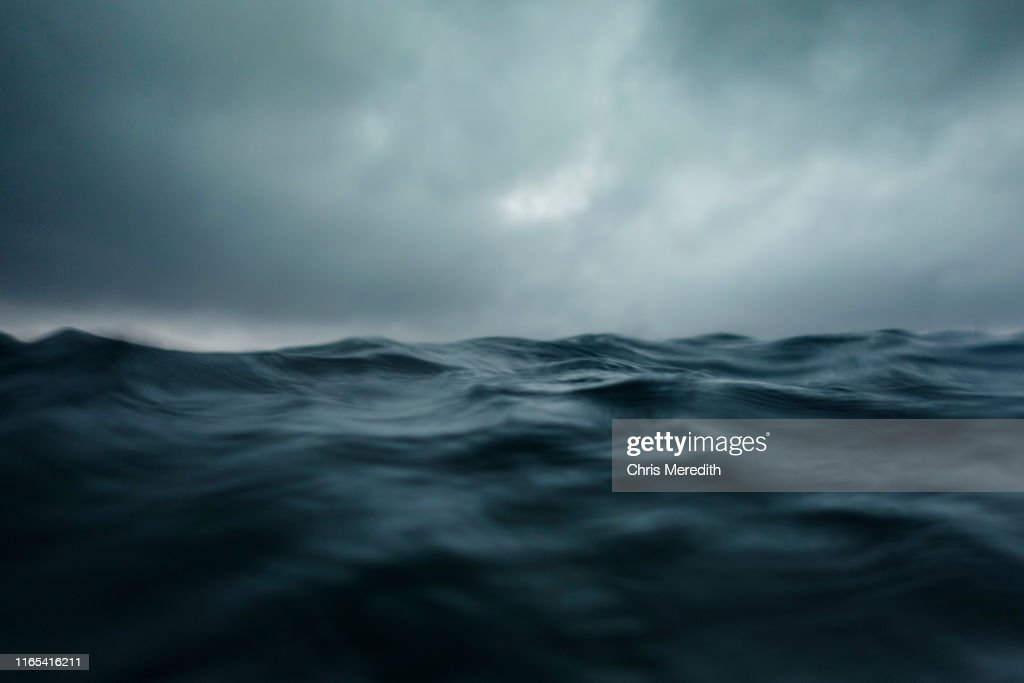 Dramatic seascape with ocean wave and dark sky : Stock Photo