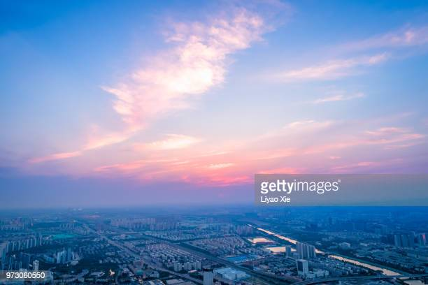 dramatic sky and cityscape - liyao xie stock pictures, royalty-free photos & images