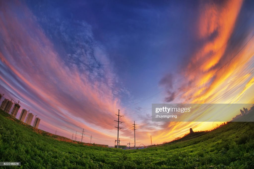 Dramatic sky and field : Stock Photo