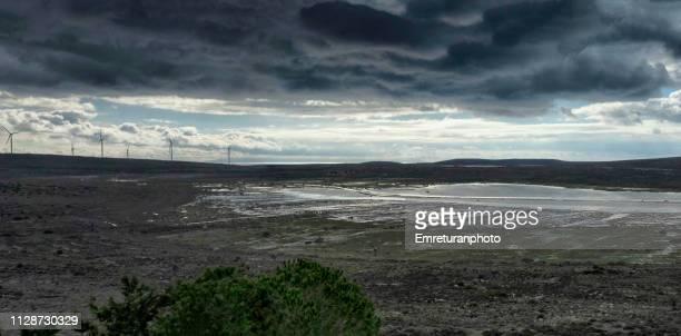dramatic sky and rain water filled ground,cesme. - emreturanphoto stockfoto's en -beelden