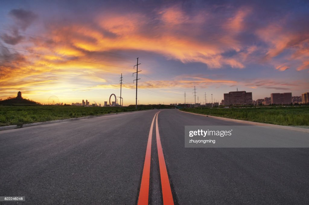 Dramatic sky and urban road : Stock Photo