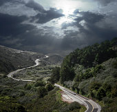 Dramatic Sky and Winding Road
