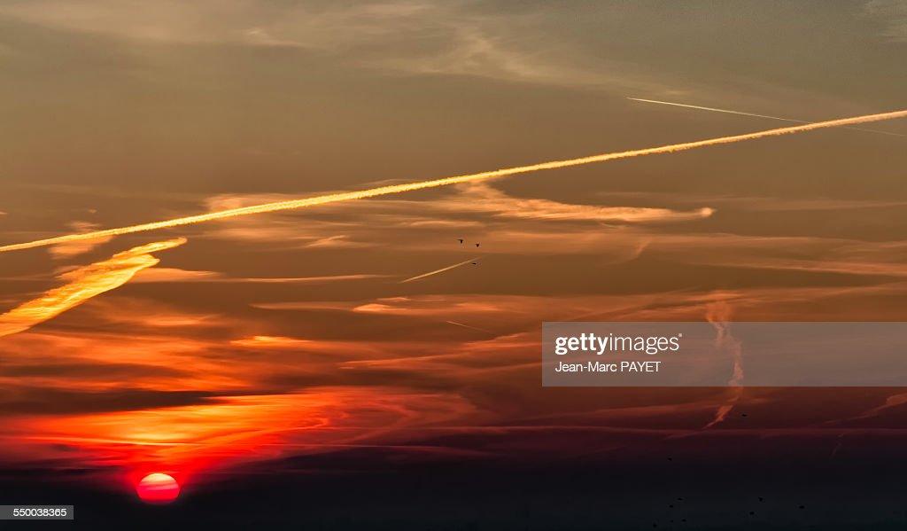 Dramatic sky at sunrise sun at the left : ストックフォト