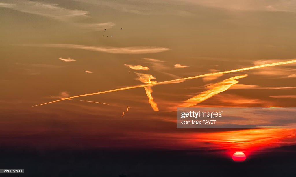 Dramatic sky at sunrise with birds silhouettes : Photo