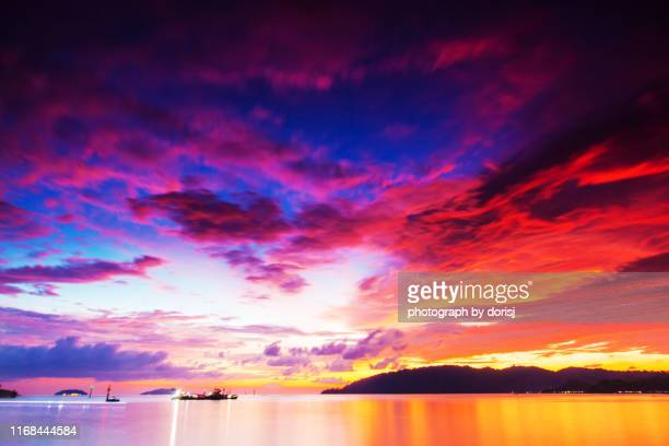 dramatic sky at sunset - kota kinabalu stock pictures, royalty-free photos & images