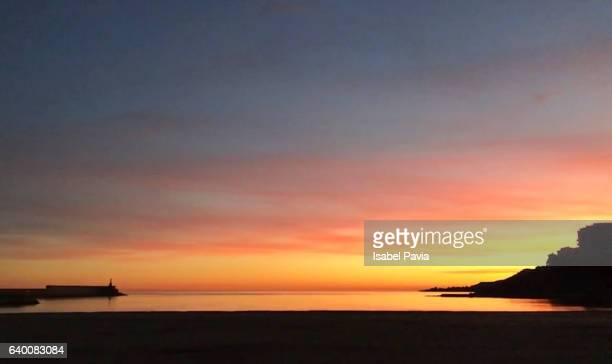 dramatic sky at sunset - sunset beach stock photos and pictures