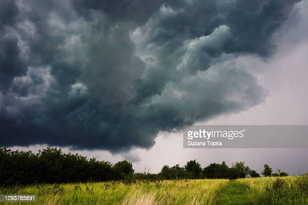 dramatic sky before the storm - romania stock pictures, royalty-free photos & images