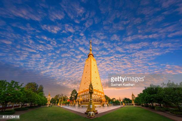 dramatic sky during sunset at wat phra that nong bua temple, northeast of thailand. - wat stock pictures, royalty-free photos & images