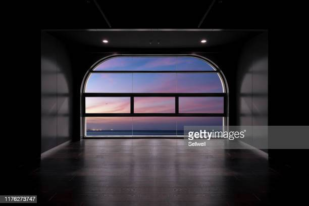 dramatic sky during sunset, from futuristic empty room-composited image. - 空気感 ストックフォトと画像