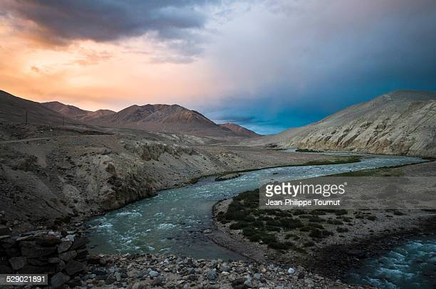 dramatic sky over a desolated land in the pamirs - badakhshan stock pictures, royalty-free photos & images