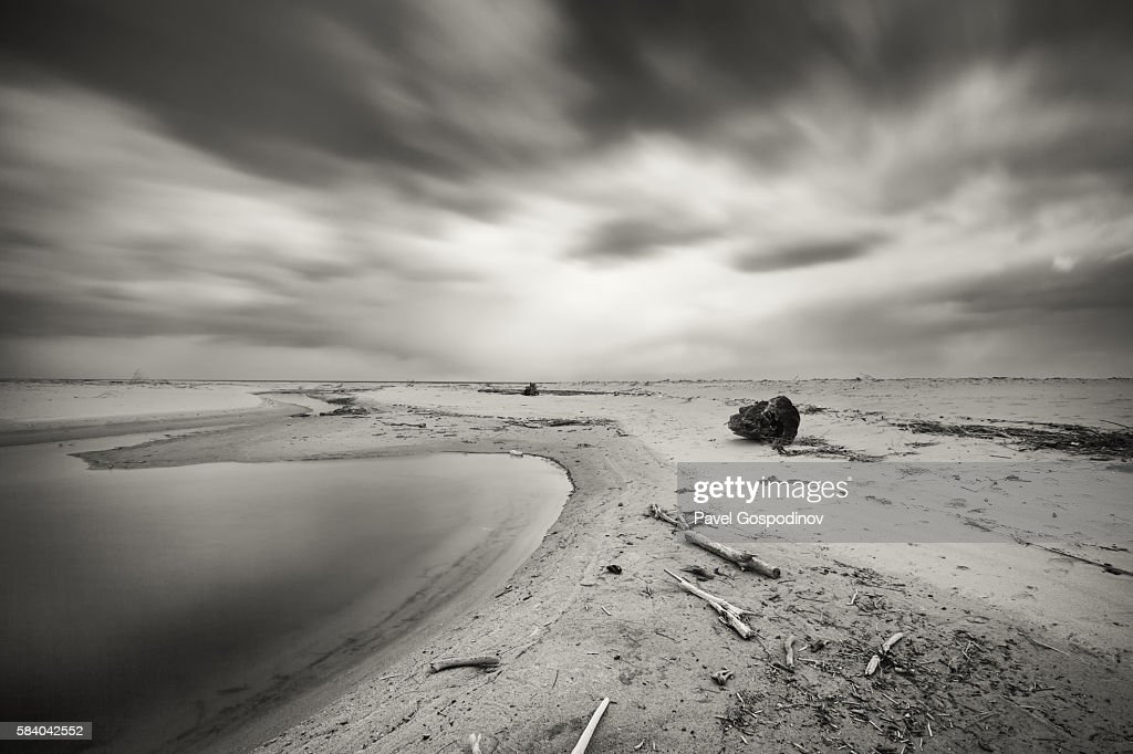 Dramatic Sky Over An Empty Beach Long Exposure Black And White