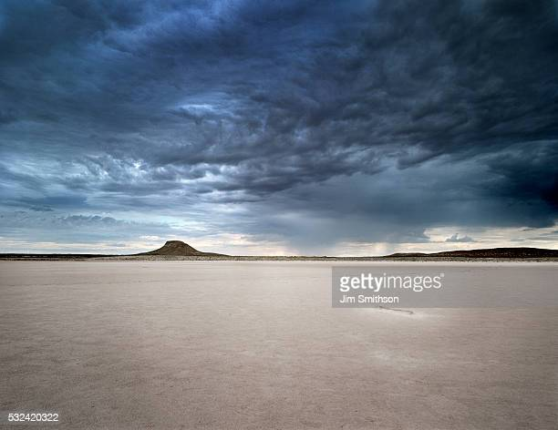 dramatic sky over dry lake bed - lake bed stock pictures, royalty-free photos & images