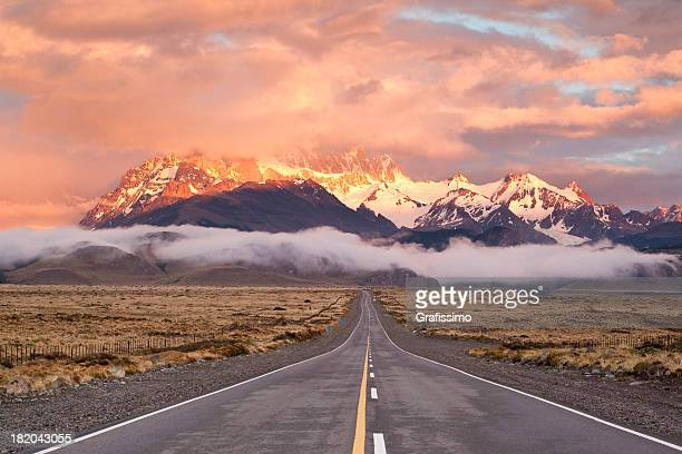 dramatic sky over empty highway in argentina patagonia - chile stock pictures, royalty-free photos & images