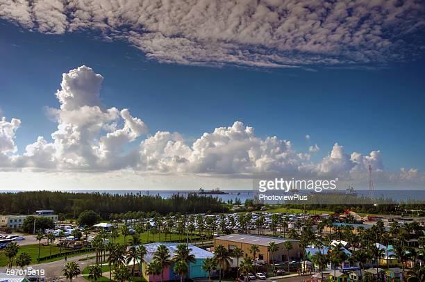 dramatic sky over freeport, bahamas - freeport bahamas stock photos and pictures