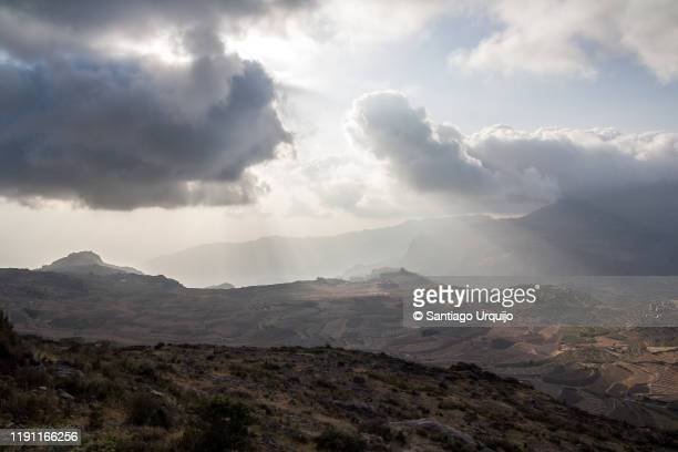 dramatic sky over haraz mountains - sanaa stock pictures, royalty-free photos & images