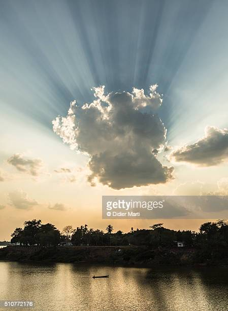 dramatic sky over pakse in south laos - didier marti stock photos and pictures