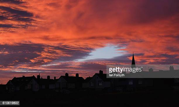 A dramatic sky over Redcar is lit by the rising sun on September 27 2016 in Redcar United Kingdom One year on since the SSI steel making plant at...