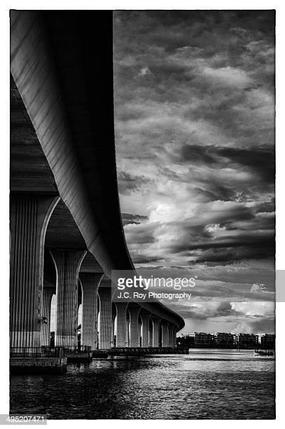 dramatic sky over roosevelt bridge - stuart florida stock pictures, royalty-free photos & images