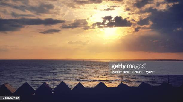 dramatic sky over sea during sunset - massimiliano ranauro stock pictures, royalty-free photos & images