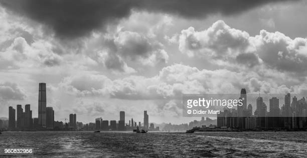 Dramatic sky over the panorama of the famous Victoria Harbour between Kowloon and Hong Kong island