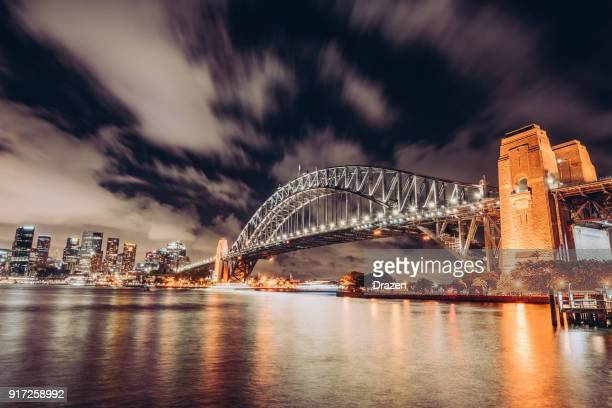 dramatic sky over the sydney harbour at night - sydney harbour stock pictures, royalty-free photos & images