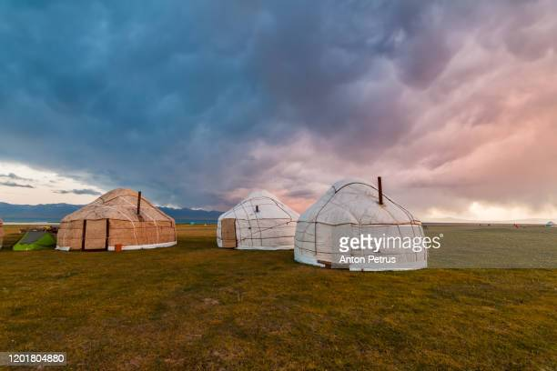dramatic sky over the yurts, mongolia - yurt stock pictures, royalty-free photos & images