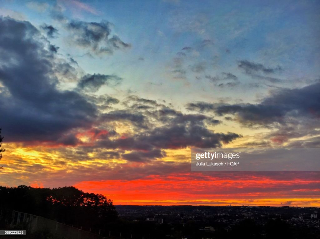Dramatic sky over town at dusk : Stock Photo