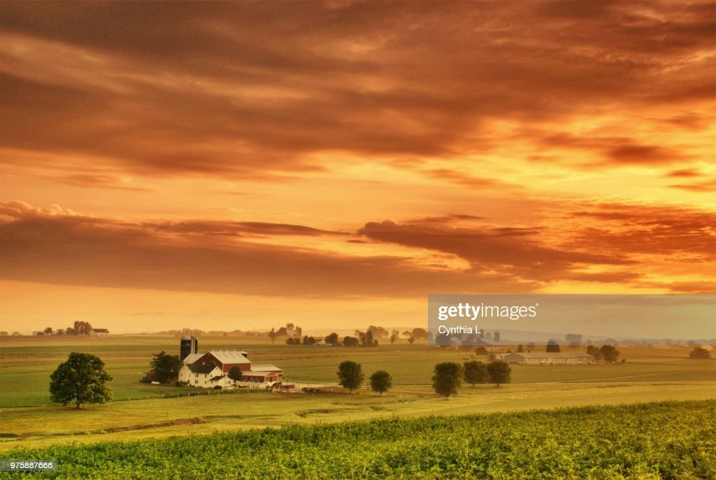 Dramatic sky over village, Pennsylvania, USA : Stock Photo