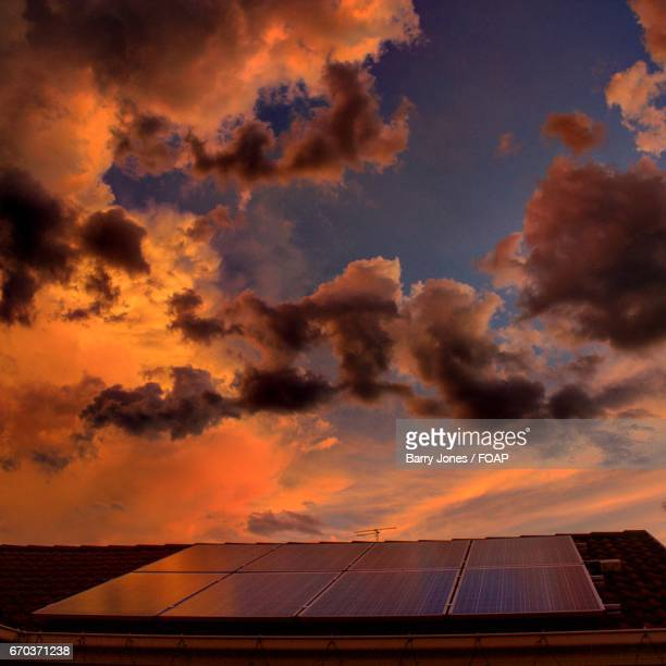 Dramatic sky reflected on solar panel