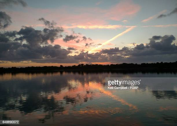 dramatic sky reflections on lake - kelli campbell stock pictures, royalty-free photos & images