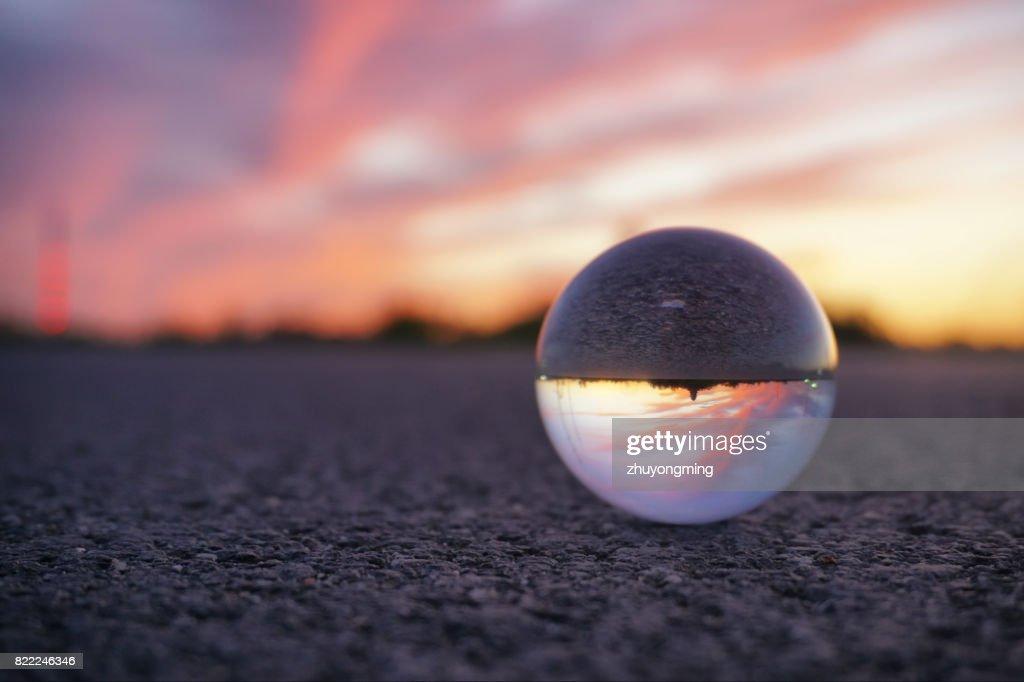 Dramatic sky through crystal ball : Stock Photo