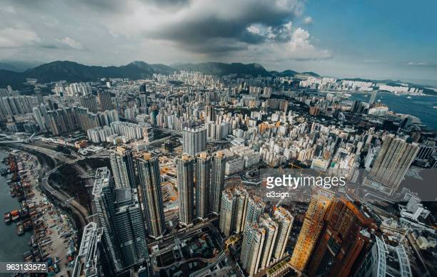 Dramatic skyline of Hong Kong and ships navigates across the Victoria Harbour in fresh morning