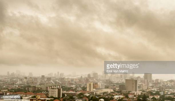 dramatic smoky stratus cloudscape over durban's inner-city. durban city, kwazulu-natal, south africa. horizontal colour image. - ダーバン ストックフォトと画像