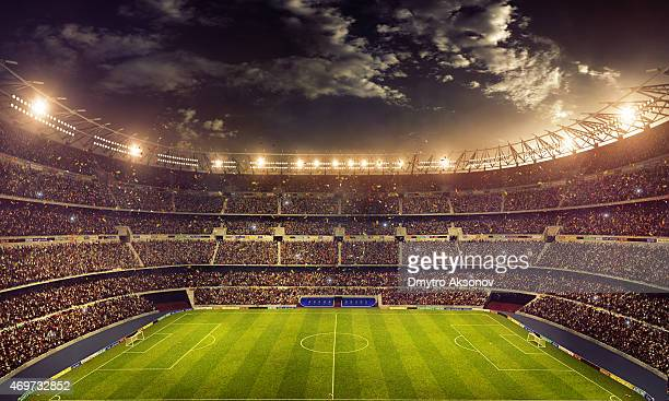 dramatic soccer stadium - sports league stock pictures, royalty-free photos & images